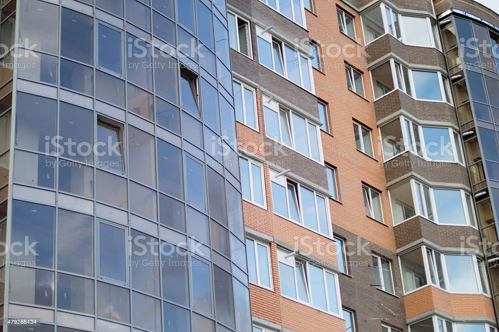 The brick multi-storey building with glass balconies