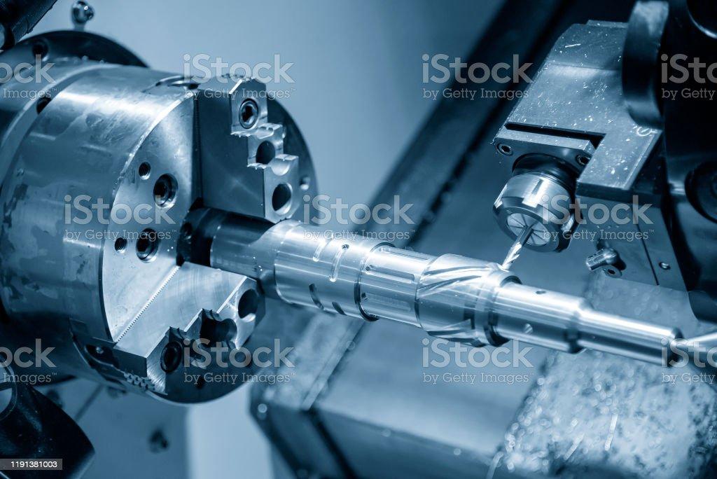 The multi-tasking CNC lathe machine cutting the automotive parts by...