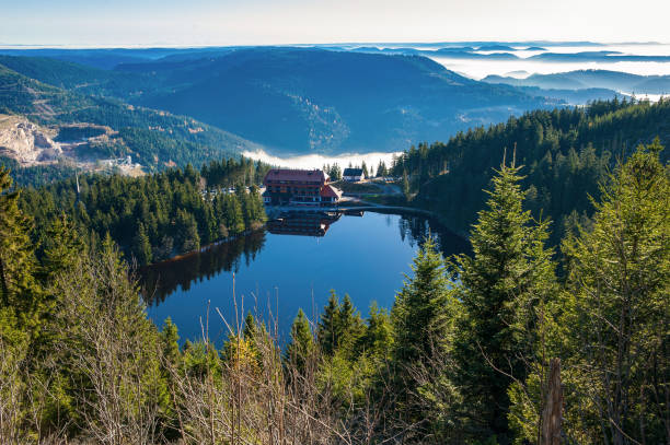 The Mummelsee lake and the mountain hotel near Seebach in the Black Forest The Mummelsee lake and the mountain hotel near Seebach in the Black Forest black forest stock pictures, royalty-free photos & images