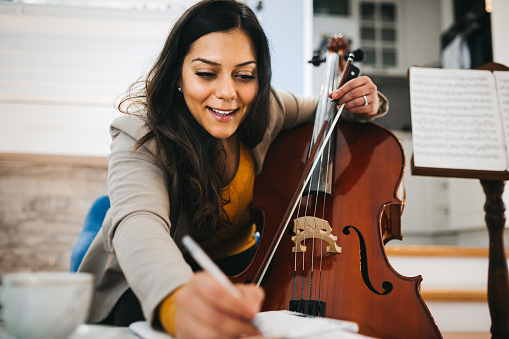 The musician composes at home