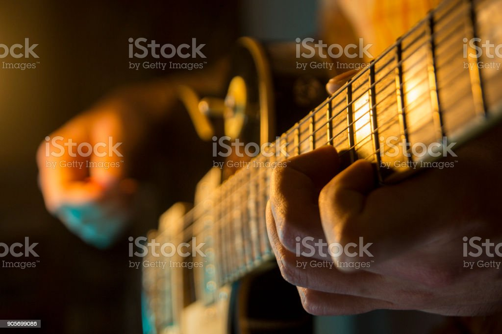 The musician is playing the electric guitar stock photo