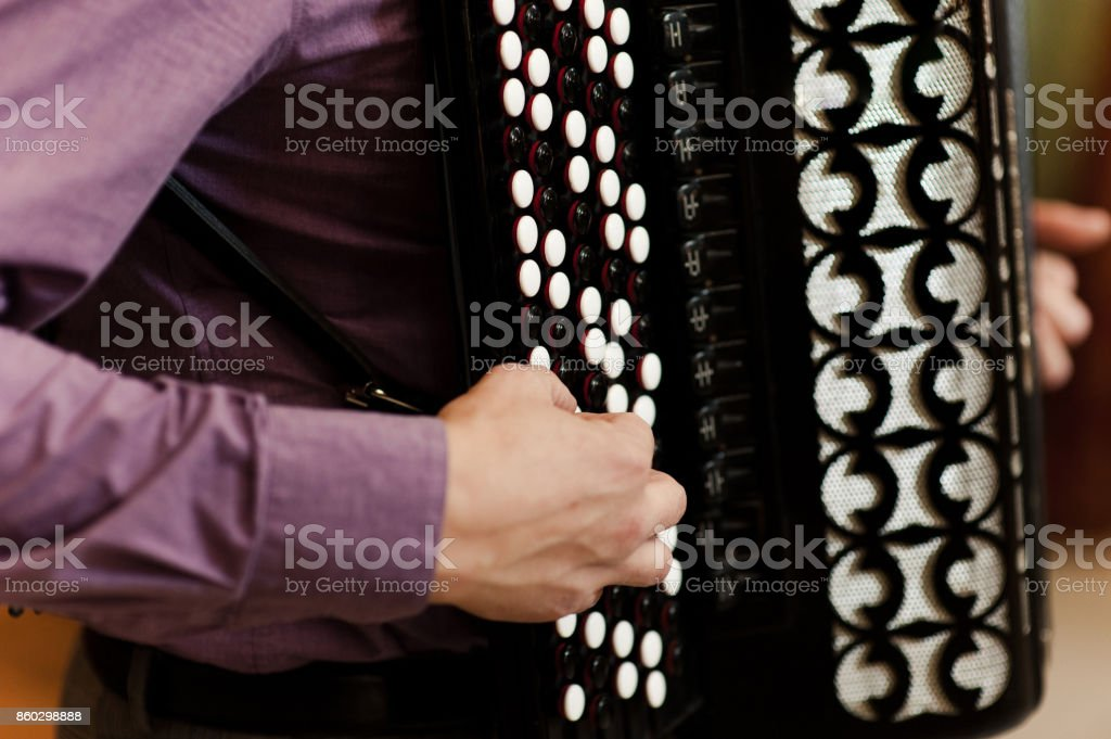 The musician playing the accordion stock photo