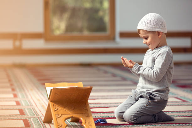 Muslim Boy Praying Stock Photos, Pictures & Royalty-Free Images ...