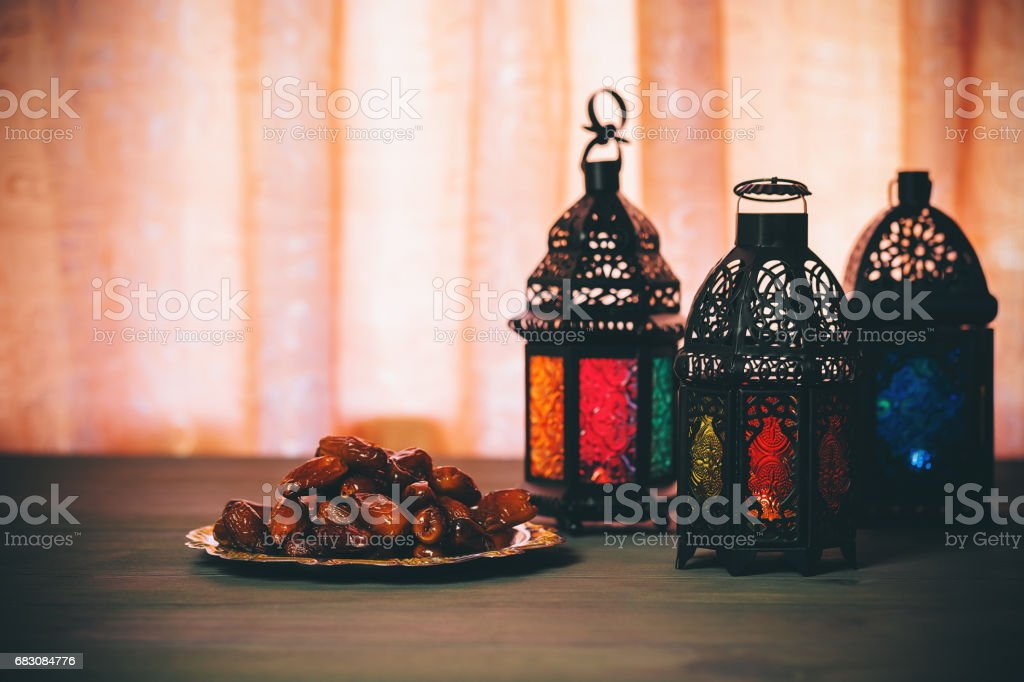 The Muslim feast of the holy month of Ramadan Kareem. Beautiful background with a shining lantern Fanus. Free space for your text. stock photo