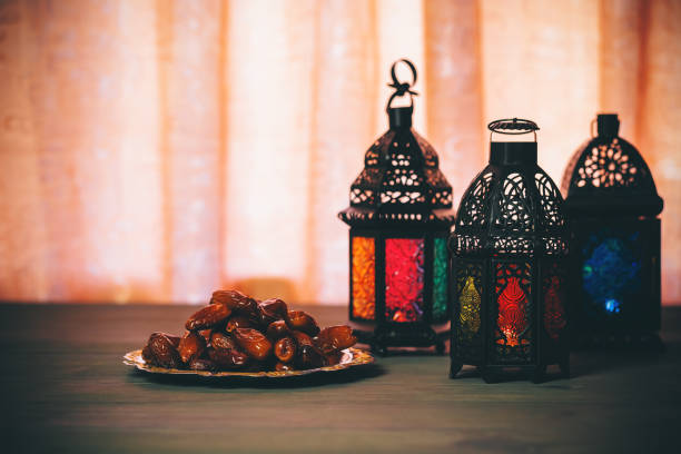 the muslim feast of the holy month of ramadan kareem. beautiful background with a shining lantern fanus. free space for your text. - ramadan stock photos and pictures