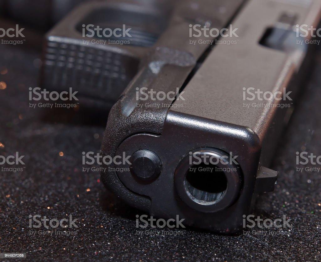 The muzzle of a black pistol stock photo