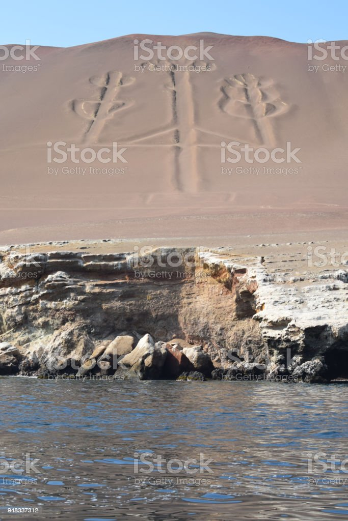 The mysterious Paracas candelabra in Peru stock photo