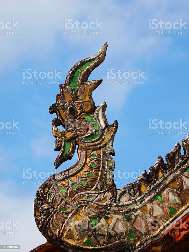 The Naga figure on the roof stock photo