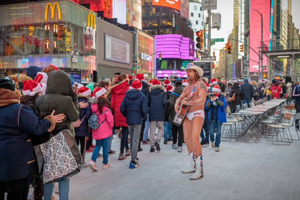 The naked cowboy entertaining at Times Square stock photo