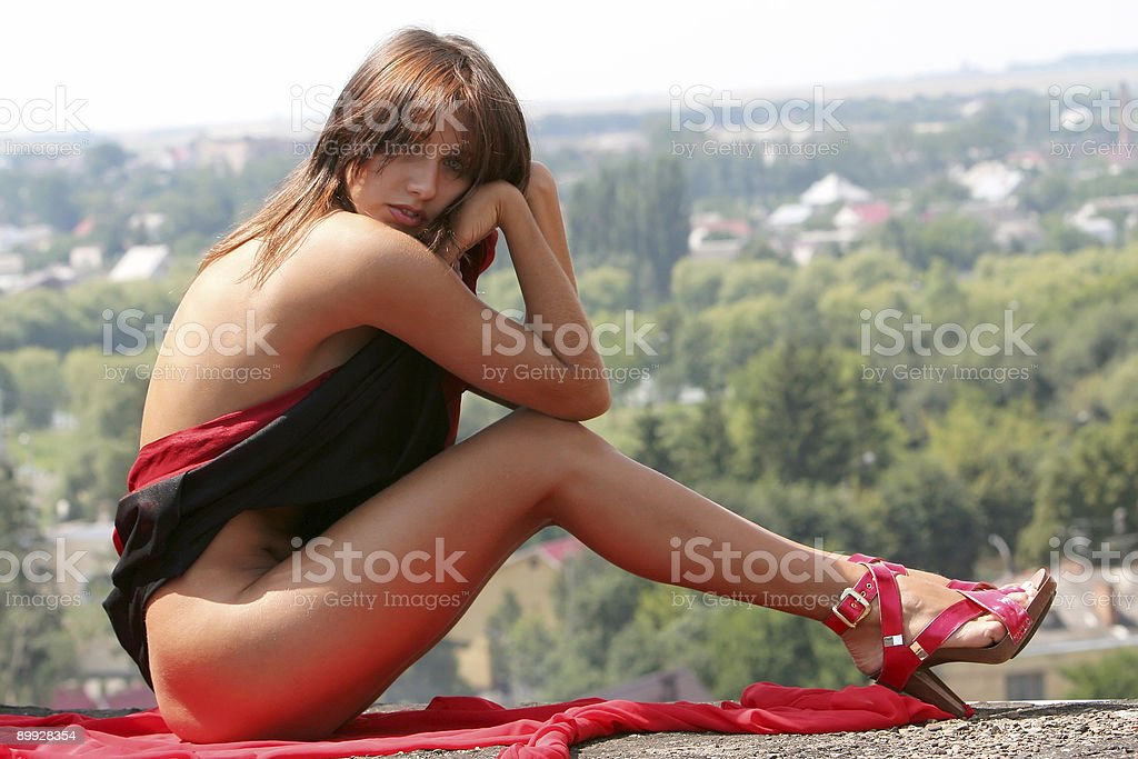 The naked girl in a red scarf. royalty-free stock photo