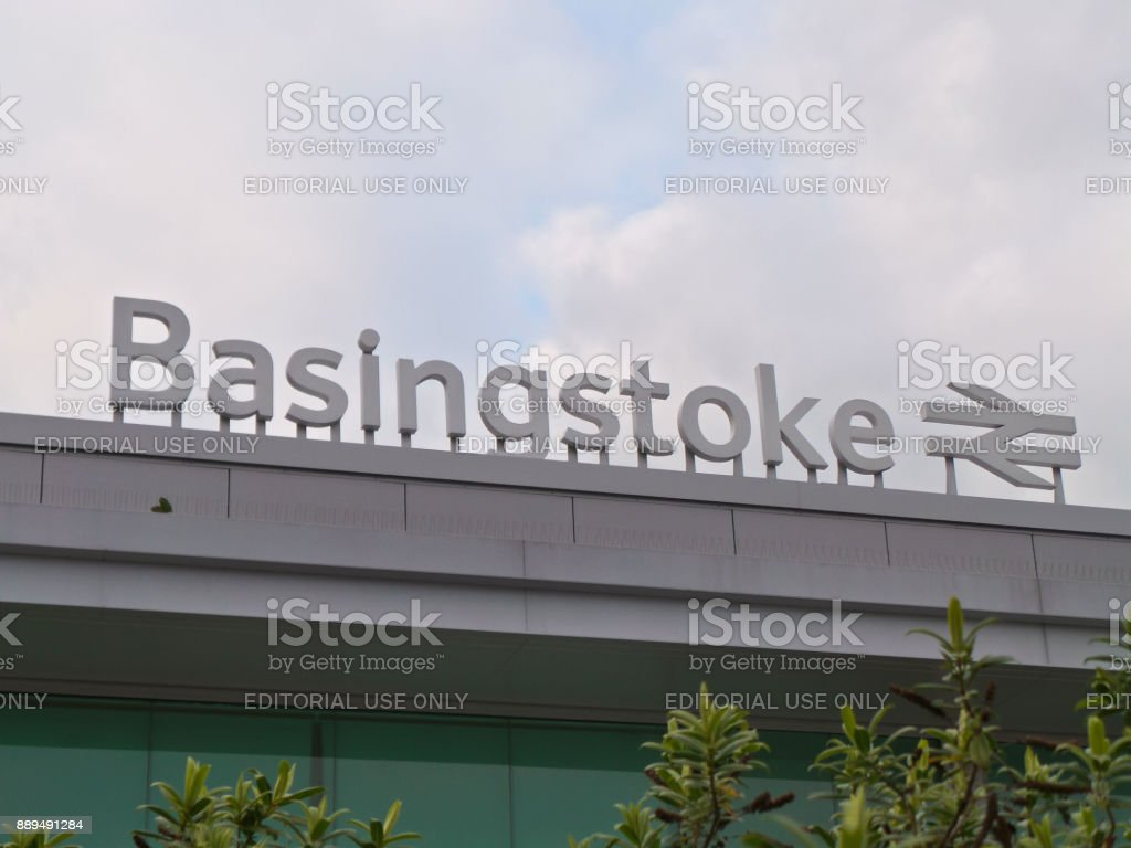 The name sign of Basingstoke train station stock photo