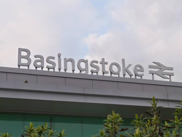 The name sign of Basingstoke train station stock photo