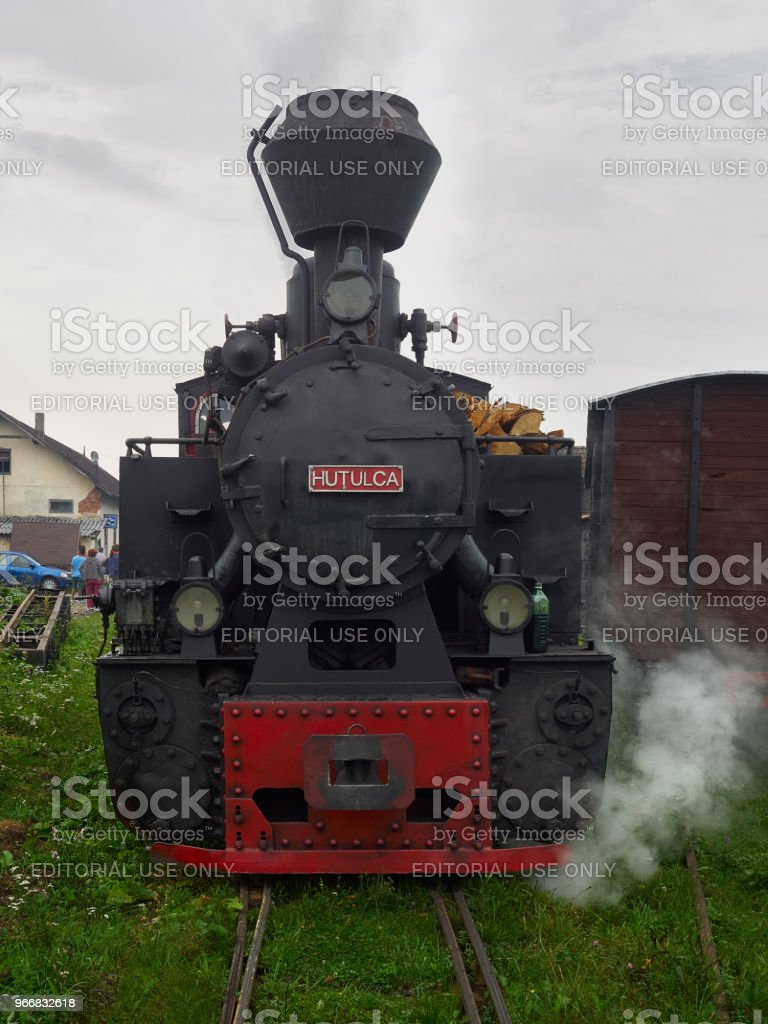 The narrow gauge locomotive Hutulca train in Bucovina makes daily trips from Moldovita to Argel stock photo