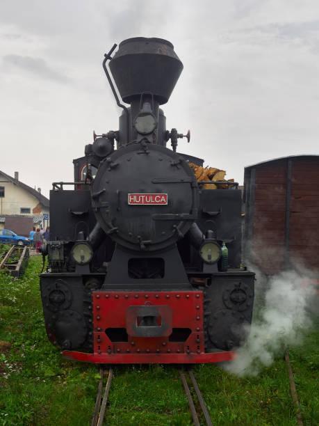 The narrow gauge locomotive Hutulca train in Bucovina makes daily trips from Moldovita to Argel stock photo