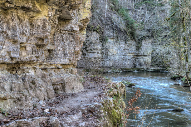The narrow hiking path leads past steep rock faces through the Wutach Gorge. stock photo