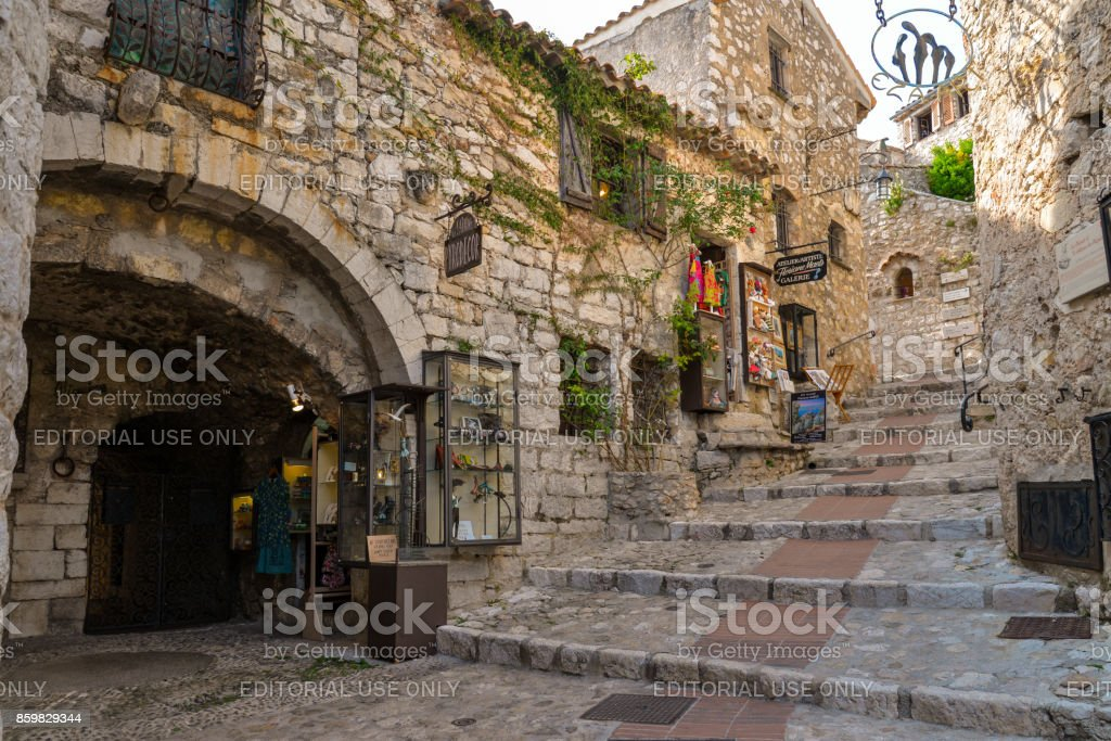 The narrow hilly street in Eze stock photo