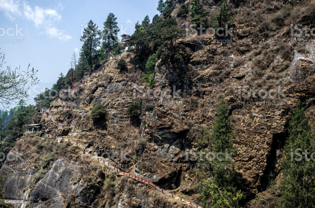The narrow steep staircases path leading to the Tiger's Nest, Taktshang monastery, Bhutan stock photo