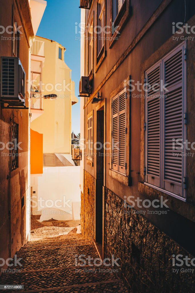 The narrow streets of Cascais, Portugal at sunset stock photo