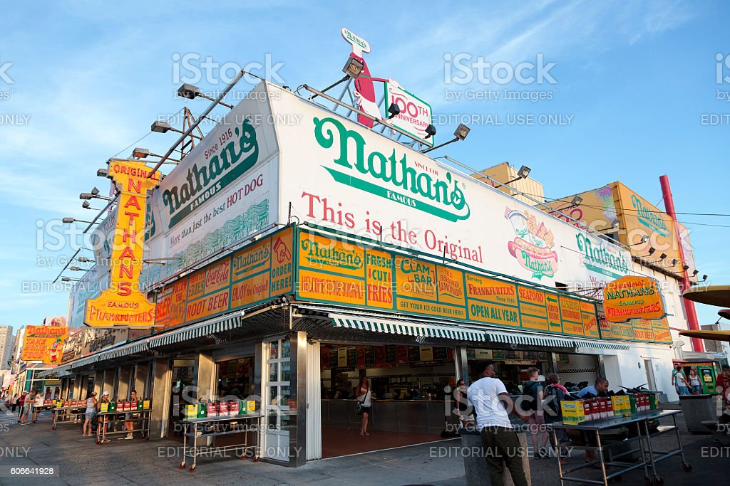 The Nathan's New York, NY, USA - August 30, 2016 : The Nathan's: The Nathan's original restaurant at Coney Island, The original Nathan's still exists on the same site that it did in 1916. Amusement Park Stock Photo