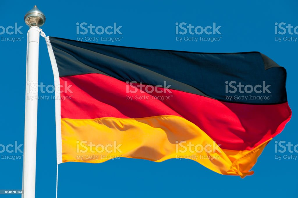 The national flag of Germany waving in the wind stock photo