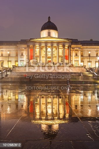 The landmark National Gallery on Trafalgar Square in London England UK on a rainy evening.