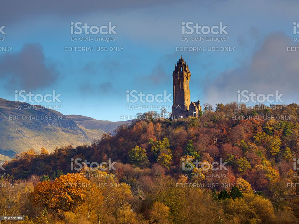 The National Wallace Monument, Stirling, Scotland. Stirling, Scotland - November 16, 2016: A view of the National Wallace Monument which is situated near Stirling, Scotland. The National Wallace Monument was designed by the Edinburgh-born Glasgow architect J. T. Rochead, and built between 1861 and 1869 on a volcanic outcrop called the Abbey Craig. Autumn Stock Photo