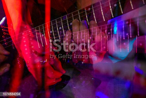 istock The neck of the guitar hand guitar player during the game 1074534204