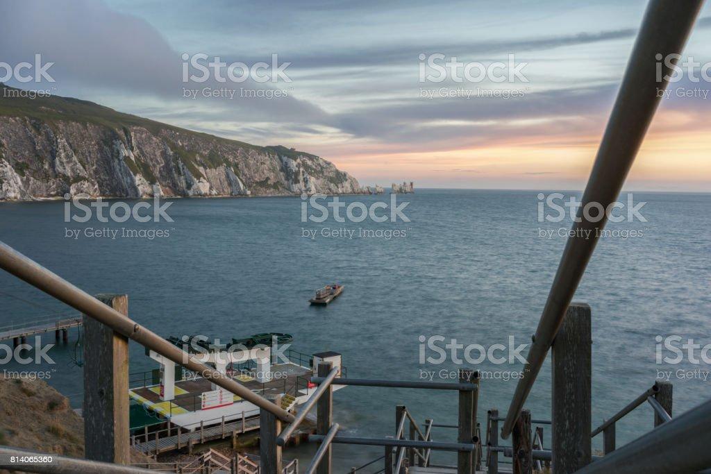 The Needles and Alum Bay beach steps stock photo