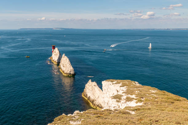 the needles rock formation on the isle of wight - english channel stock pictures, royalty-free photos & images