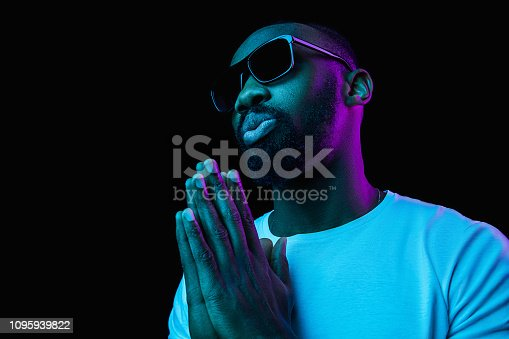1095939686istockphoto The neon portrait of a young smiling african man 1095939822