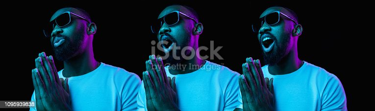 1095939686istockphoto The neon portrait of a young smiling african man 1095939838