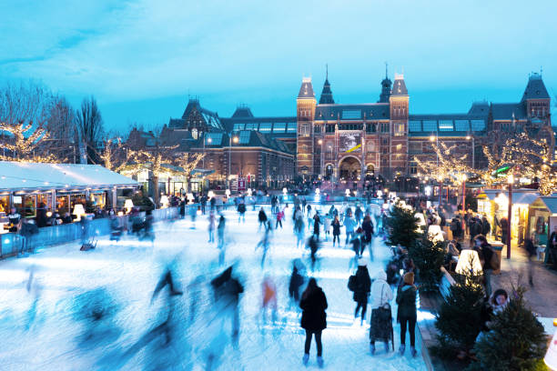 The Netherlands, Amsterdam - December 18 2018: winter ice rink in Amsterdam on the museum square, the Netherlands The Netherlands, Amsterdam - December 18 2018: winter ice rink in Amsterdam on the museum square, the Netherlands museumplein stock pictures, royalty-free photos & images