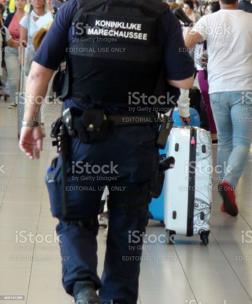 The Netherlands Military police Officer Walking Around At Departure Hall Of Schiphol Airport Amsterdam The Netherlands Europe stock photo