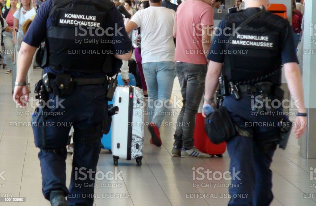 The Netherlands Military police Officers Walking Around At Departure Hall Of Schiphol Airport Amsterdam The Netherlands Europe stock photo