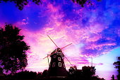 The Netherlands Windmills silhouettes over colorful sky at sunset.Dutch windmill on twilight at dusk.Evening Landscape with windmill.