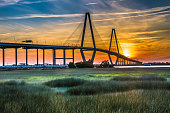 The Ravenel Bridge crosses the Cooper River and connects Charleston with Mount Pleasant South Carolina. It is 13,200 feet long (2.5 miles) and is the third longest cable stayed bridge in the Western Hemisphere.