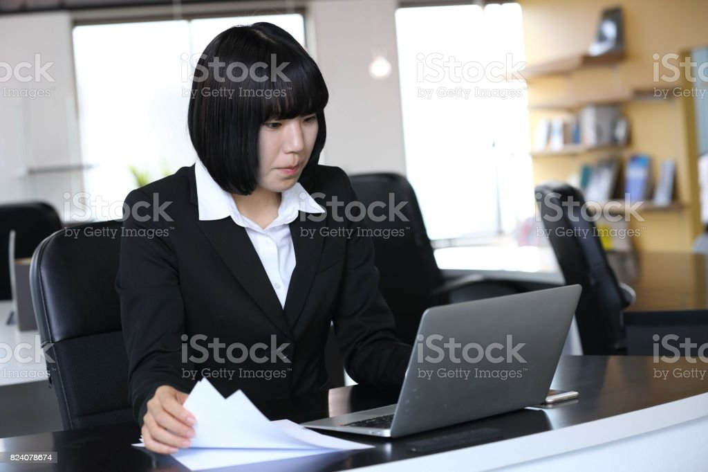 The new employee who inputs the data of the document into a PC stock photo