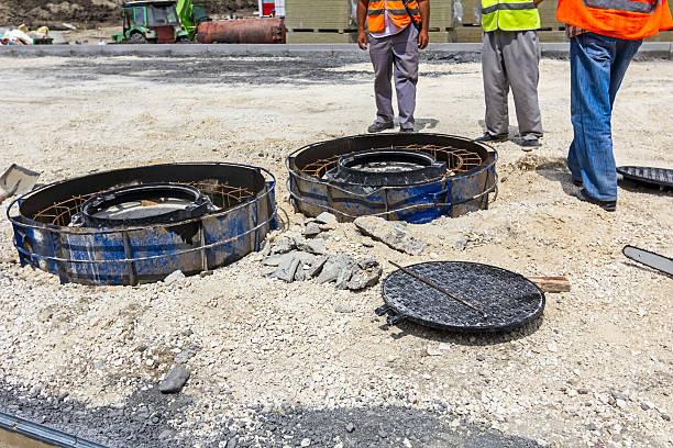 The new manhole Preparation is in progress to assembly demountable mold for concrete pouring around the new manhole. confined space stock pictures, royalty-free photos & images