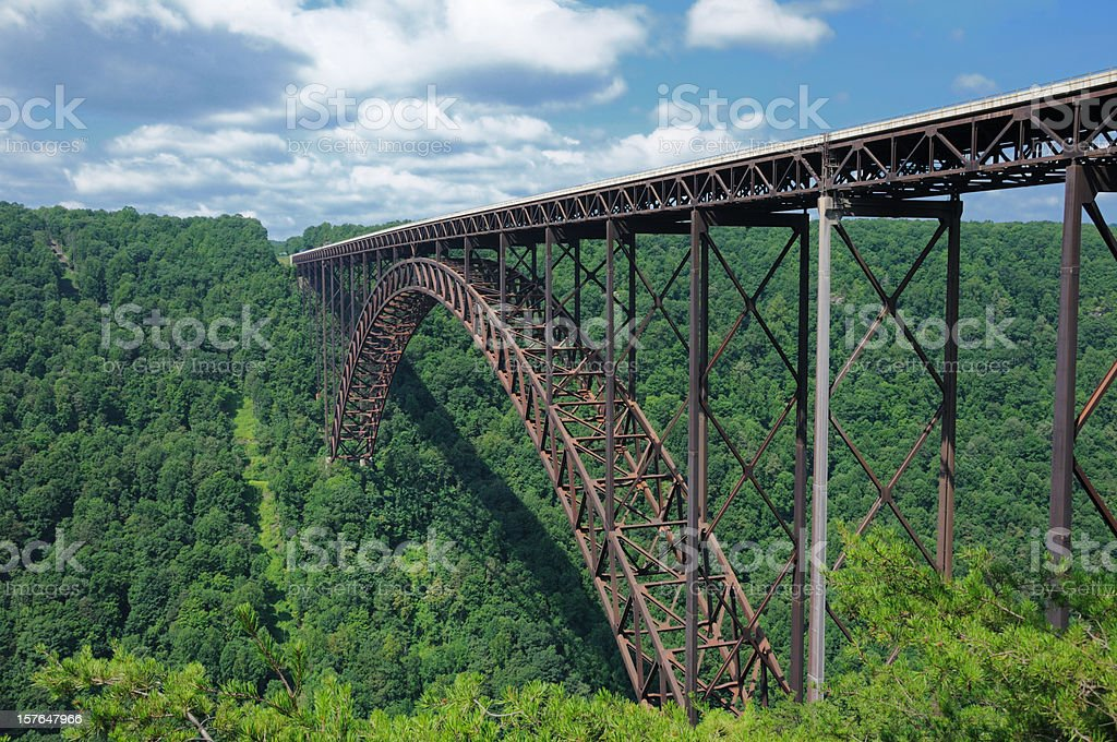 The New River Gorge Bridge surrounded by trees stock photo