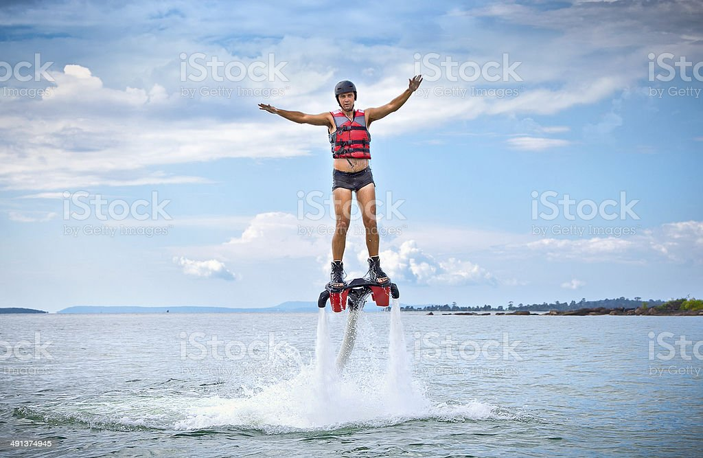 The new spectacular extreme sport called  flyboard stock photo