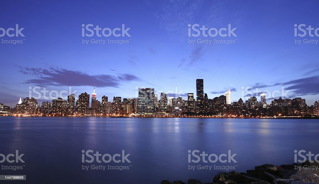 The New York City skyline at night from across the river royalty-free stock photo