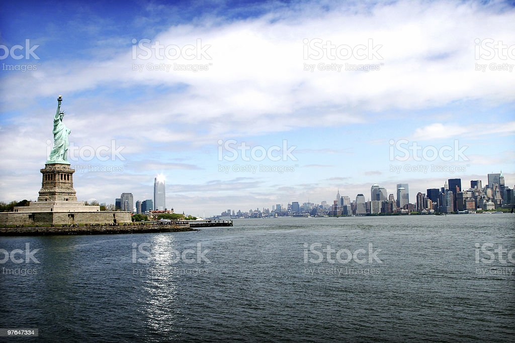 The New York City skyline with the Statue of Liberty stock photo