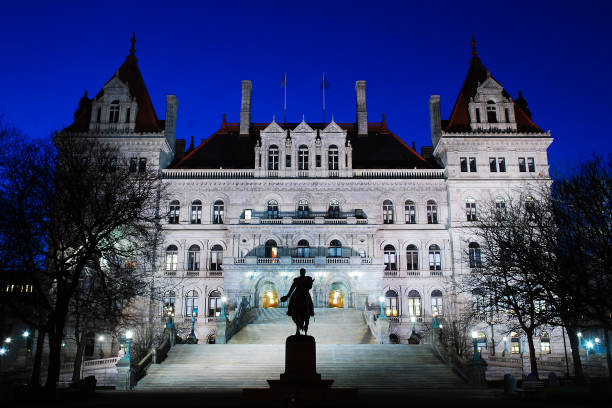 The New York State Capitol at Night The New York State Capitol in Albany is illuminated at dusk albany county new york state stock pictures, royalty-free photos & images