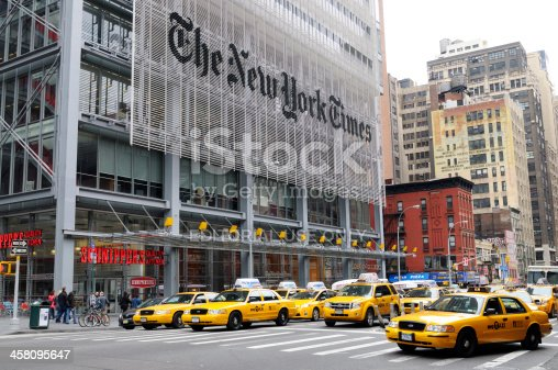 New York City, USA - May 14th 2011: People and yellow cabs in front of The New York Times Building. It\'s located on 620 8th Avenue in Midtown Manhattan and was completed in 2007 by the famous italian architect Renzo Piano.