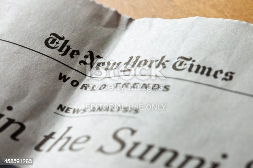 Ljubljana, Slovenia - March 27, 2011: A World trends page of The New York Times weekly edition in Slovenian newspaper Delo. The New York Times publishes their editions in many mayor newspapers in several countries worldwide.