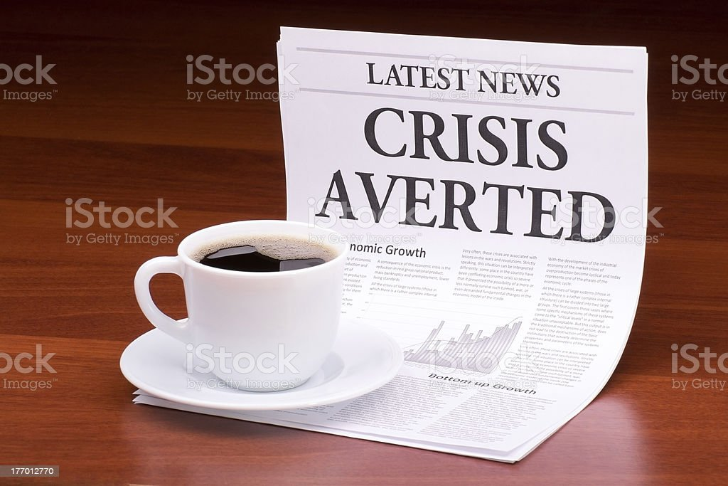 The newspaper CRISIS AVERTED royalty-free stock photo