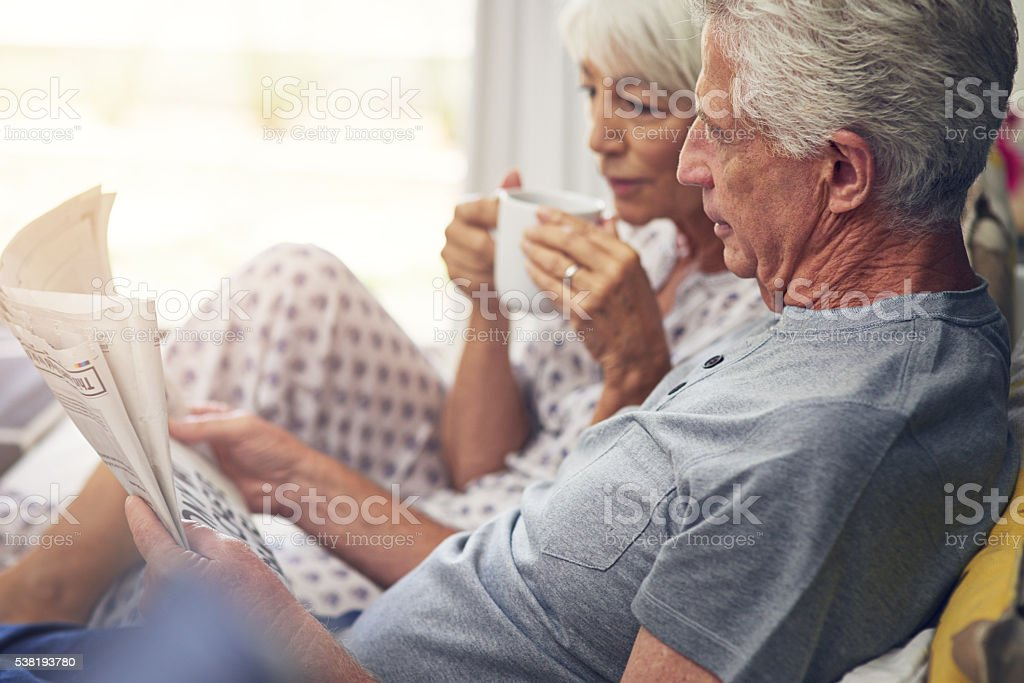 The newspaper gives them a start for the day stock photo