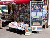 """""""Barcelona, Spain - August 08, 2012 :  man is entering to the kiosk of news papers and magazines in Barcelona"""""""