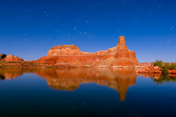 The night behind the house boat Long Exposure shot at night to capture the stars and rocks at powell lake powell stock pictures, royalty-free photos & images