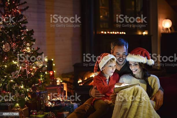 The night christmas family sharing a digital tablet picture id488532998?b=1&k=6&m=488532998&s=612x612&h=xguyv zix9udyxpskmnbj12zebhh om9q7sdj1frqia=